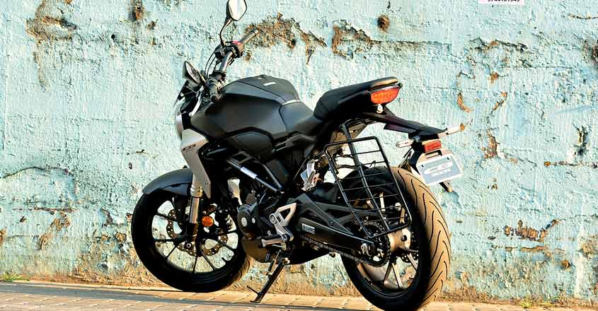 CB300R is Honda's international offering in the entry-level naked sports category. A sports bike much-awaited by enthusiasts in India. Why? There is only one answer, quality. You could blindly trust the build quality, says an admirer. Moreover, enthusiasts are expecting the same quality levels seen in international model here too. Is it true? Is it only about quality? What about performance? Well, here is our test ride report:  Global star  The CB300R was first launched in 2017. It then came as a replacement for the CB300F model, which was a naked bike with sporty looks. However, CB300R is a mix of sportiness and retro style.  Superb finish  When we first saw CB300R at EVM Honda Wing World Cochin, we understood why there is so much talk about the quality aspect - the build quality is pretty impressive. The paint quality and finishing too are top class.  Honda is calling it the Neo-Sports Cafe. It sports the chiselled looks of a street sports bike. The body panels are sleek. The round headlamp ooze quality and design excellence. The blacked-out engine and alloys stand out. The fuel tank is long and muscular. Knee recesses are deep and can comfortably accommodate your knees. The silver scoop next to it adds to its looks.  The CB300R shares its design elements with its bigger brother CB100R. Engine and other components are in black theme. There are some silver finishes at some places, which add to its premium feel.  The LCD instrument console is fully digital that is clearly visible in bright daylight too. It shows gear shift indicators, average mileage and instant fuel efficiency etc. It features a flat handle bar that supports an aggressive riding position. The quality of switches is top notch.  The position of horn switch could create some confusion initially. The bike is built around a diamond type trellis frame. It is designed in such a way that the rider's weight is brought closer to the centre of the motorcycle.  The CB300R weighs only 147 kg thus making it a pr