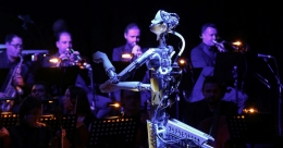 Music by numbers? Robot conducts human orchestra in Sharjah