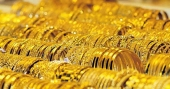 Gold price touches a record high for 11th day