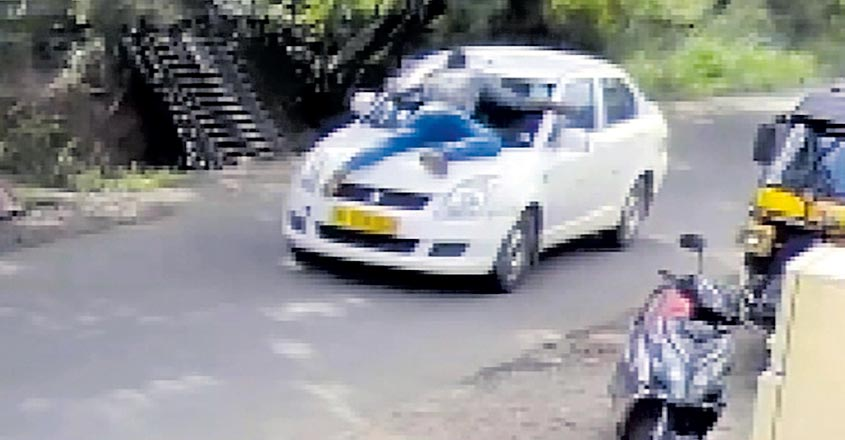 Youth clings on to bonnet as car driver speeds away on Kochi road after hit
