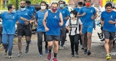 Police officer marks his retirement with a 14-km run