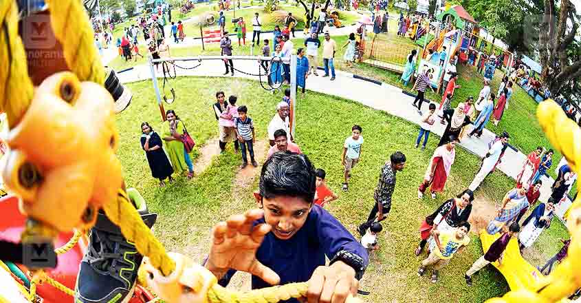 Children, adults throng renovated civic park