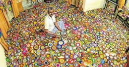 This Kottayam hobbyist collects Oommen Chandy badges since 2004