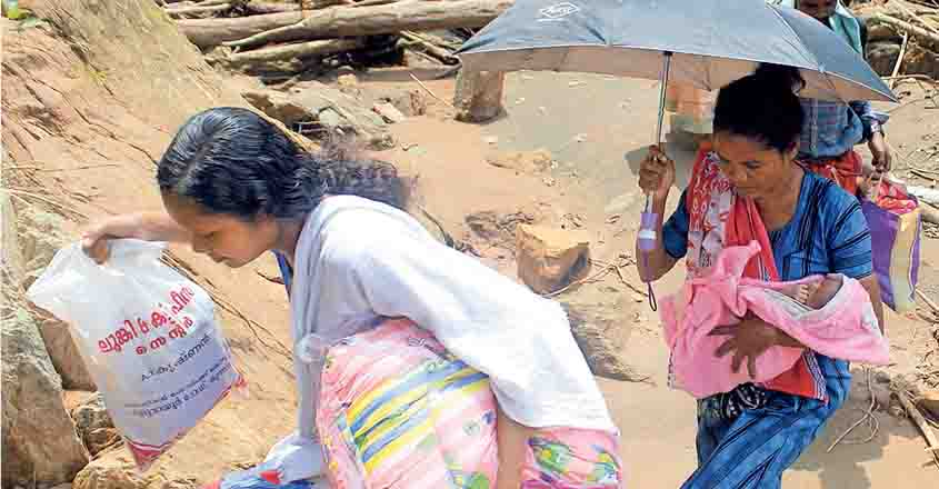 Mother hikes 2 km with four-day-old baby to flood-hit colony