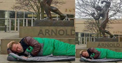 How times changed: Arnold 'sleeps' under his own statute in front of hotel