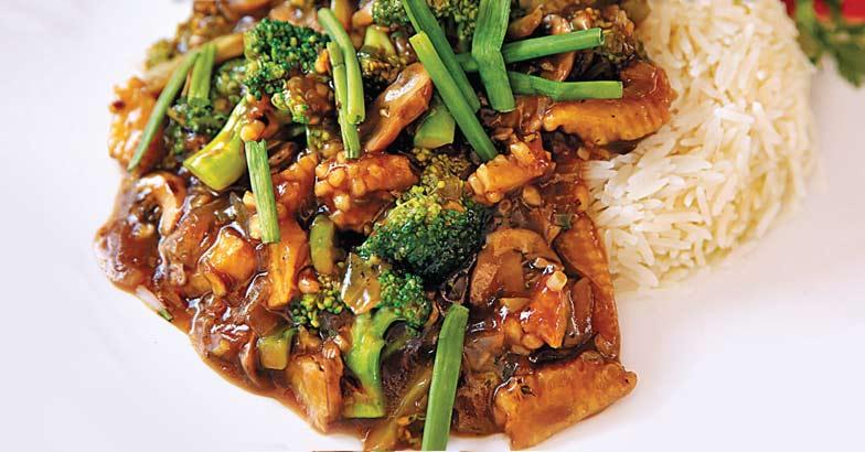 Stir fried mushroom and broccoli on rice