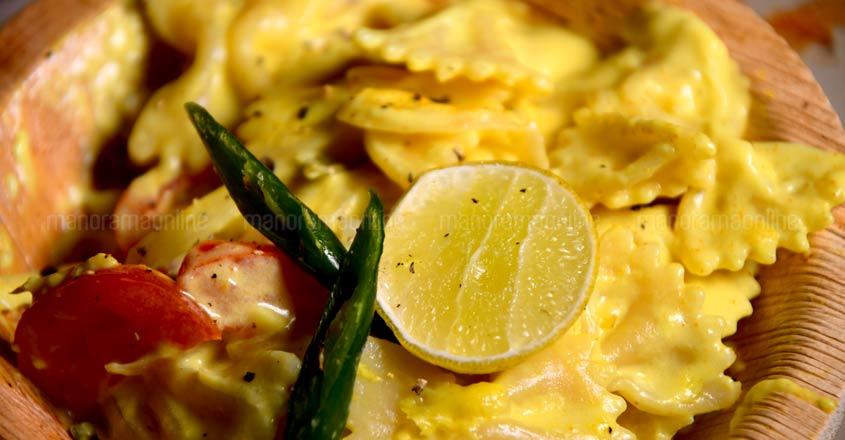Vegan pasta in coconut milk and tender coconut pulp