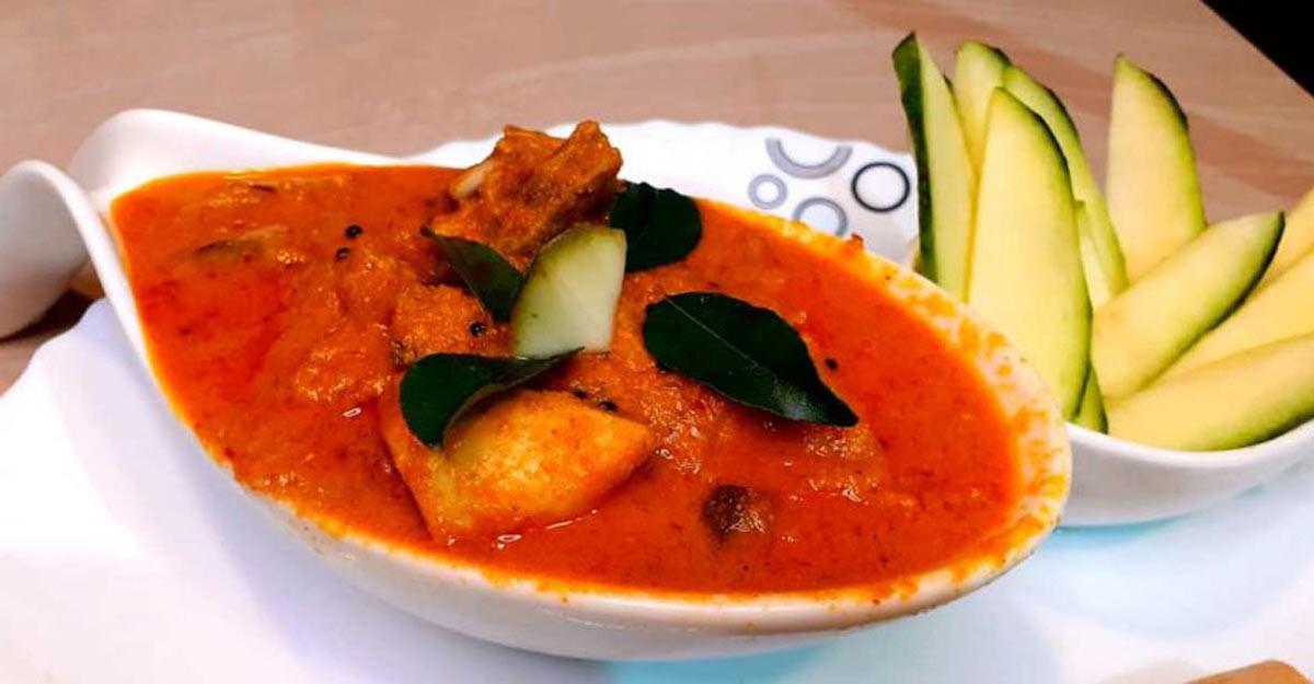 Raw mango chicken curry