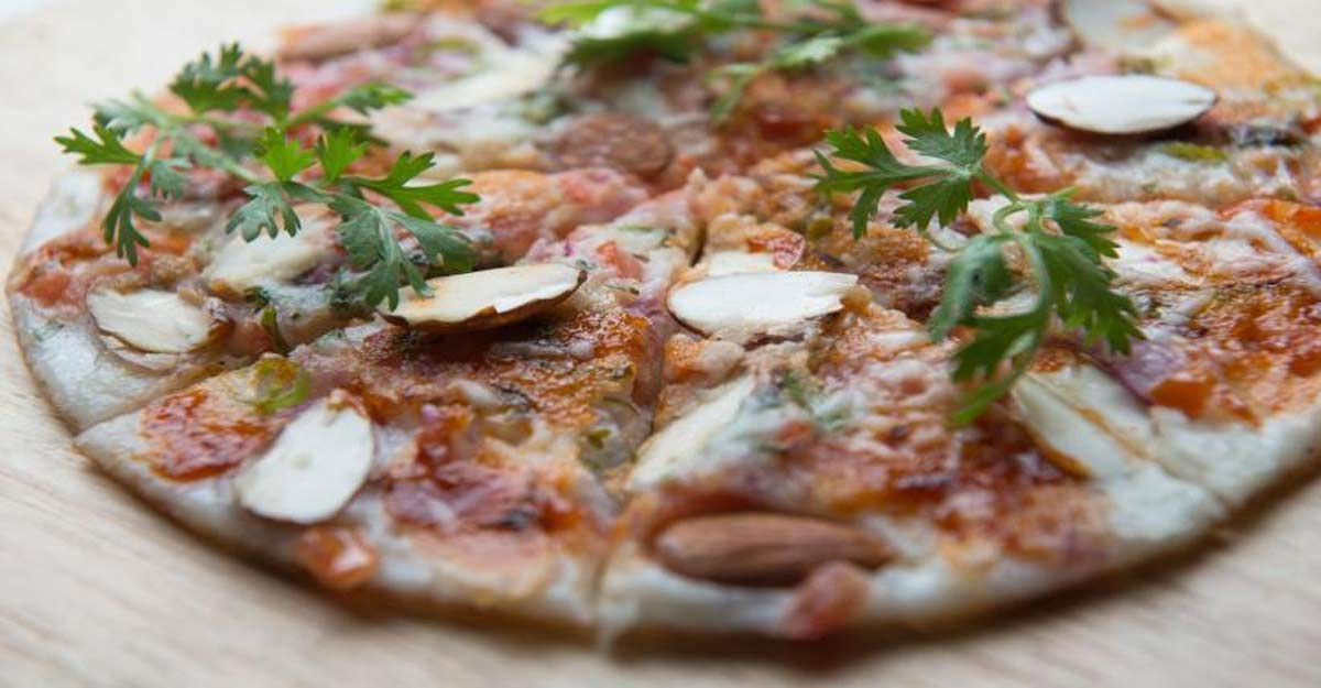 Toasted almonds and tomato uthappam pizza