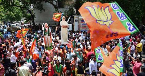BJP workers celebrate as saffron party dethrones Congress in K'taka