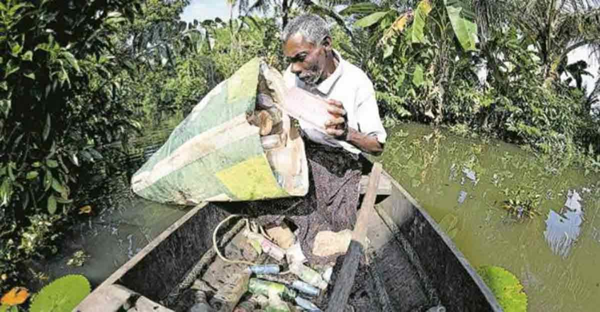 Afflicted by polio, Kumarakom man picks up plastic from backwaters for a living