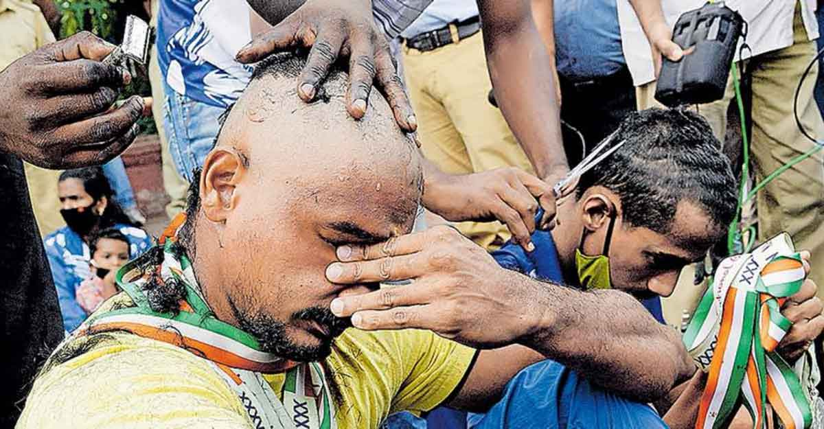 Promised jobs not given: Sportspersons shave their heads in protest