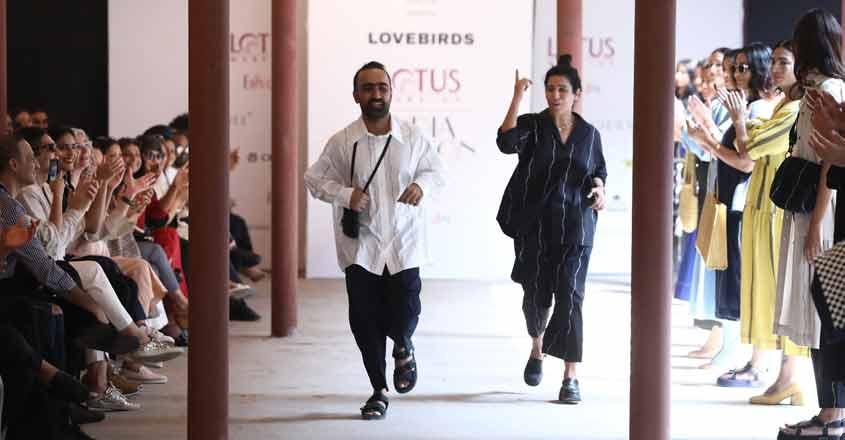 New Delhi: Fashion designers Gursi and Amrita Khanna get applause from the audience and the models who showcased the collection of their fashion label Lovebirds on the fourth day of Lotus Make-up India Fashion Week, in New Delhi on Oct 12, 2019. (Photo: IANS)