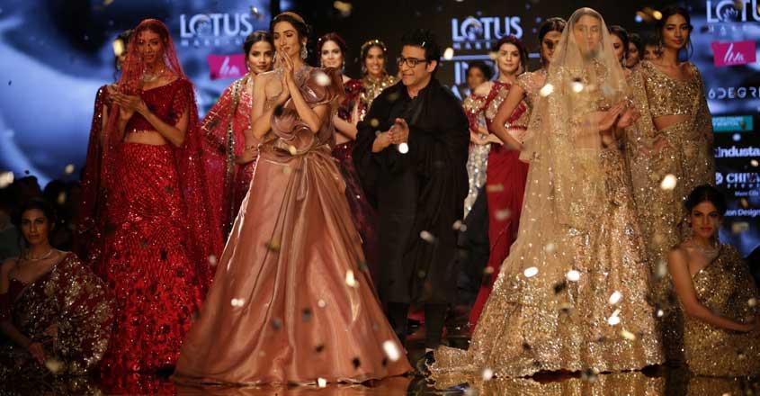 New Delhi: Models showcase a creation of fashion designer Suneet Varma on the second day of Lotus India Fashion Week in New Delhi, on March 14, 2019. (Photo: Amlan Paliwal/ IANS)