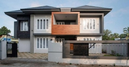 Fabulous design makes this North Paravur house simple and classy
