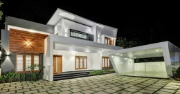 This white-themed contemporary house in Kalanjoor is truly magnificent