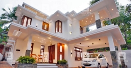 Classy features and vast interiors make this Calicut house a vision in white