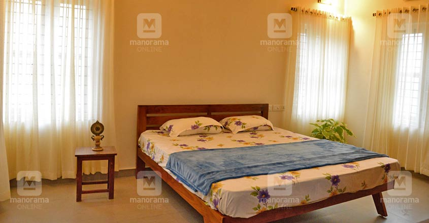 cute-green-house-kottayam-bed