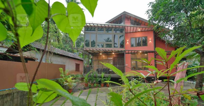 This sturdy, durable Kozhikode house in fibre cement boards is a spectacle