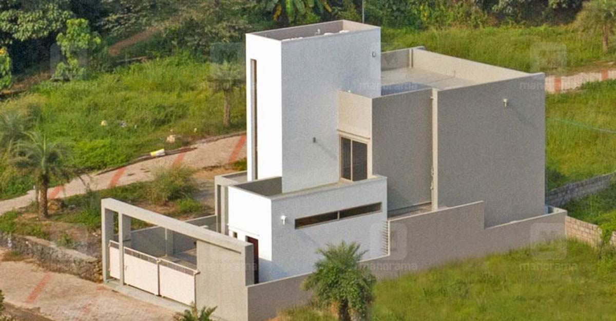 A fabulous cost-effective house in Kakkanad is built on just 4.25 cents