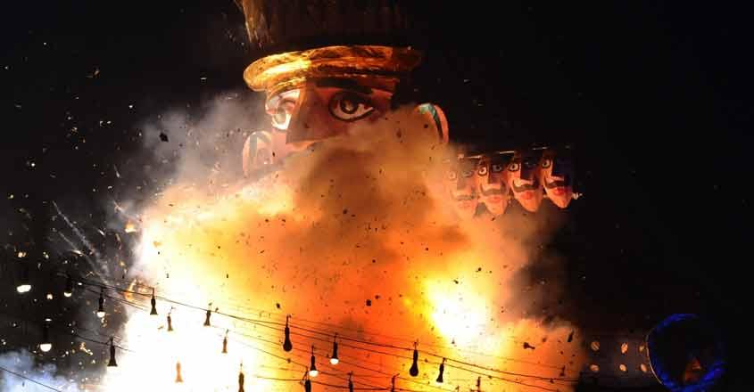 New Delhi: An effigy of Ravana being burnt on 'Vijaya Dashmi' at Ramlila Maidan in New Delhi on Oct 19, 2018. (Photo: IANS)