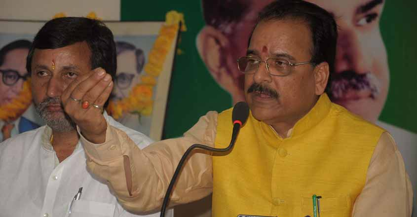 Dehradun: The leader of opposition in the Uttarakhand assembly and BJP leader Ajay Bhatt addresses a press conference in Dehradun, on July 23, 2015. (Photo: IANS)