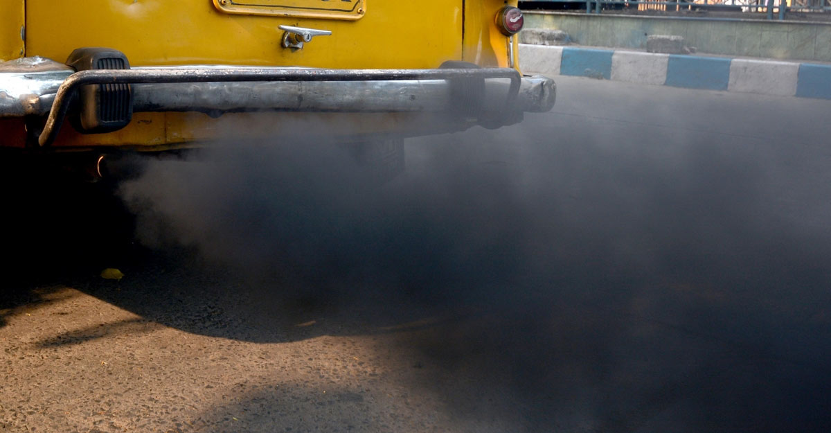 Kolkata: A car emitting smoke which is leading to air pollution, seen on the eve of World Environment Day, in Kolkata on June 4, 2019. (Photo: Kuntal Chakrabarty/IANS)