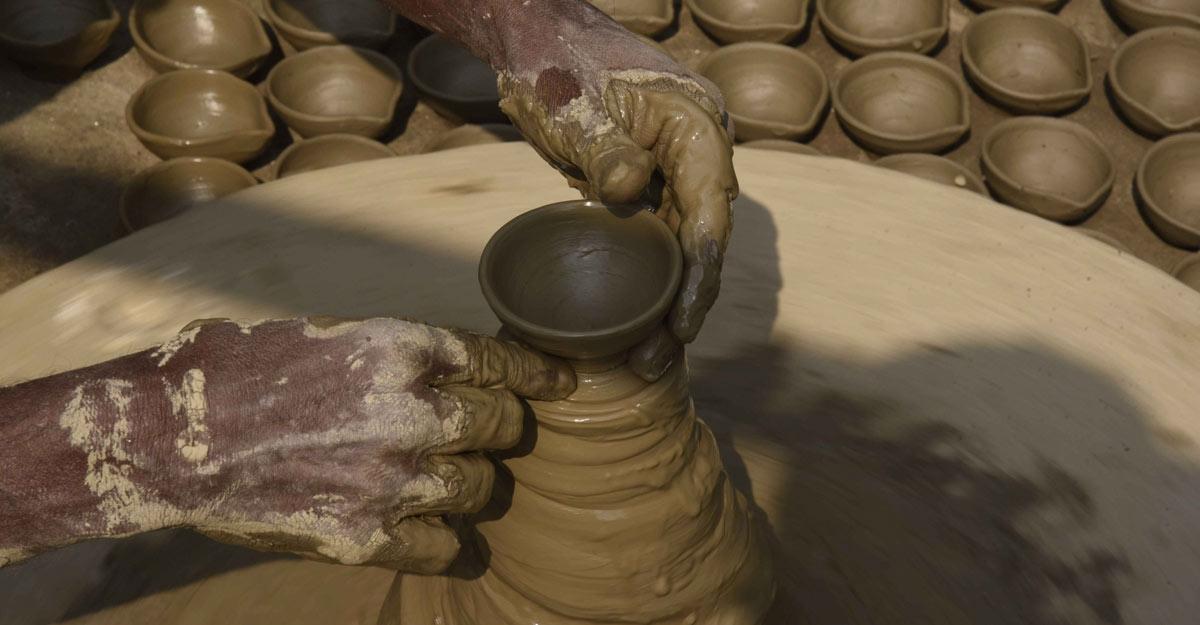 Patna: A potter sculpts clay to make earthen lamps ahead of Diwali celebrations, in Patna on Nov 5, 2020. (Photo: IANS)
