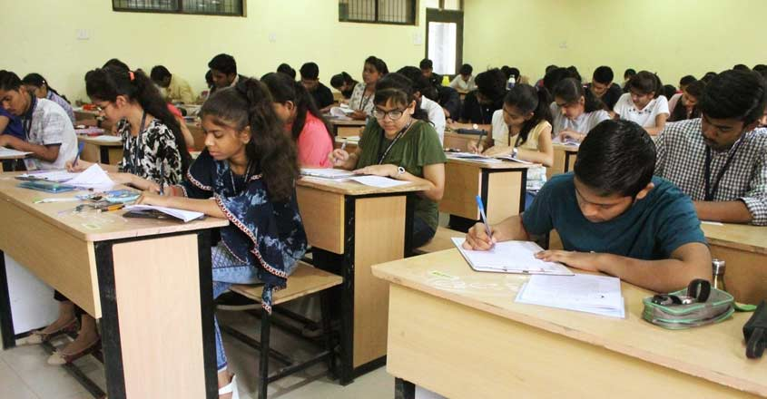 Nagpur: Students busy writing answers during class 12 board exams conducted by MSBSHSE  (Maharashtra State Board of Secondary and Higher Secondary Education) in Nagpur on Feb 21, 2018. (Photo: IANS)