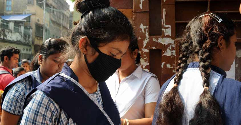 Kolkata: A student wearing a mask as a precautionary measure against Coronavirus, arrives to appear for her first exam as the West Bengal Class 12 Board Exams commenced from today, in Kolkata on March 12, 2020. (Photo: Kuntal Chakrabarty/IANS)