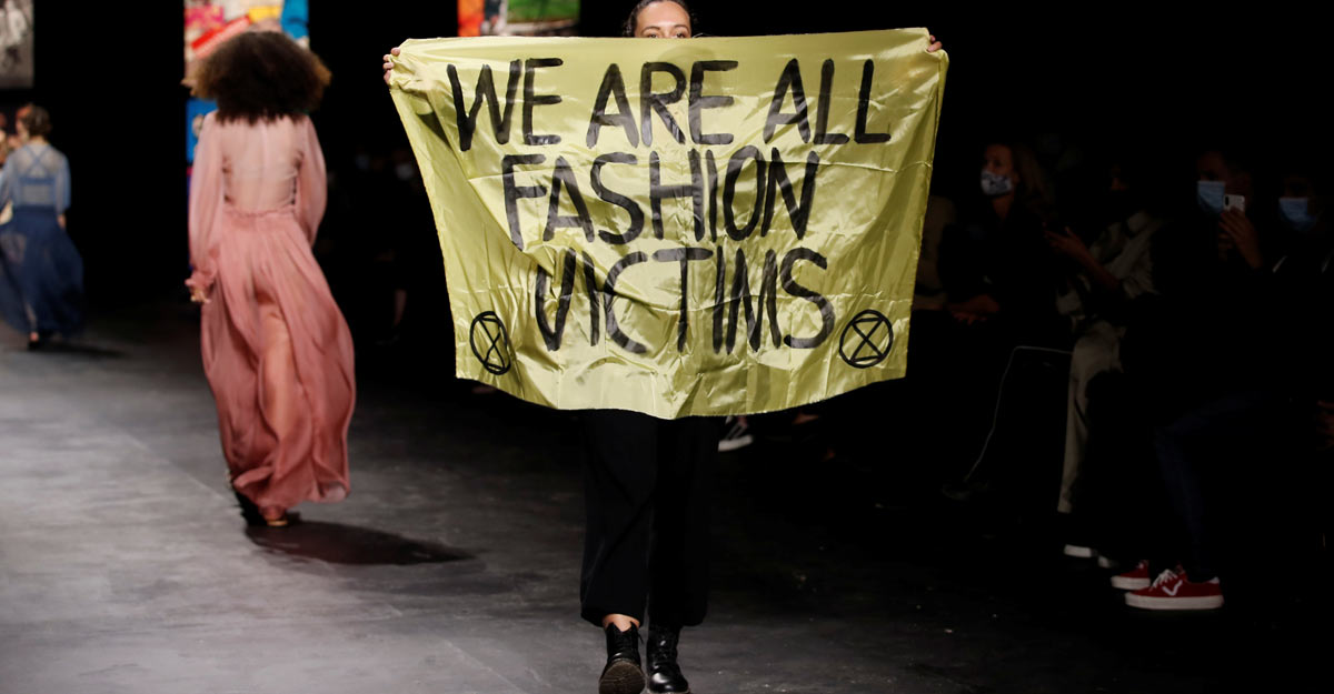 Climate change protester sneaks in, walk runway at Dior in Paris with banner