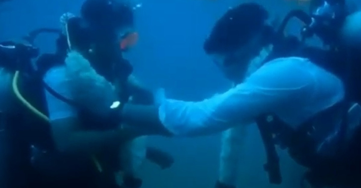 Dressed in traditional clothes, Tamil couple ties knot 60 ft under water