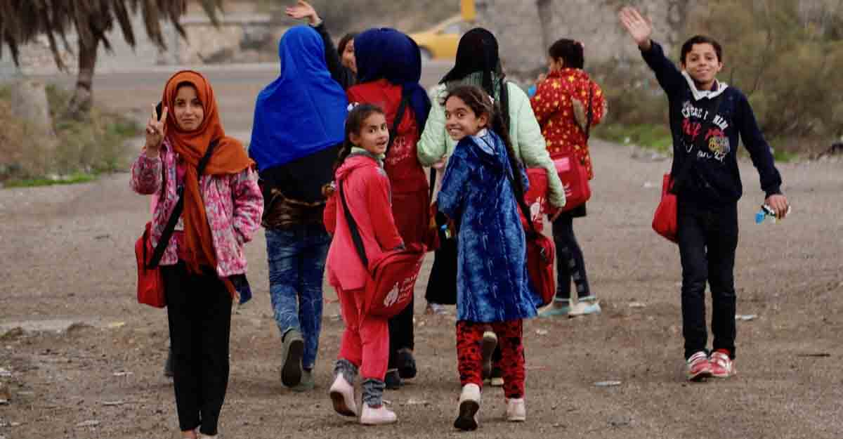 Baghdad, Dec. 30, 2018 (Xinhua) -- Displaced children leave for home after one day's study on the