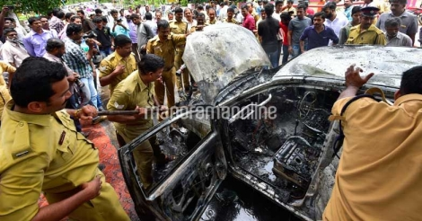 Moving car catches fire in Kollam