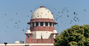 COVID-19 guidelines on face masks & social distancing violated with impunity: SC