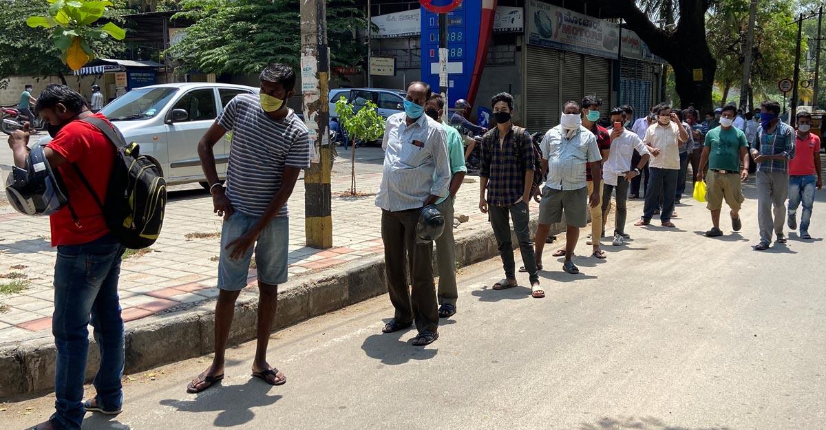 Chaos as liquor shops open after 40 days, Delhi imposes 70% 'special corona  tax' | India News | Manorama