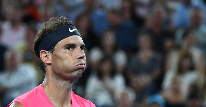 Rafael Nadal reacts after his defeat to Dominic Thiem during their Australian Open clash.