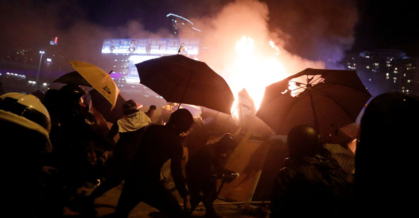 Hong Kong police threaten to use live bullets as standoff with protesters escalates