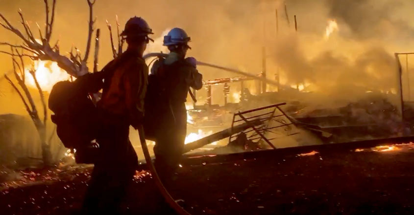 Firefighters make gains against wildfire in Southern California farm country