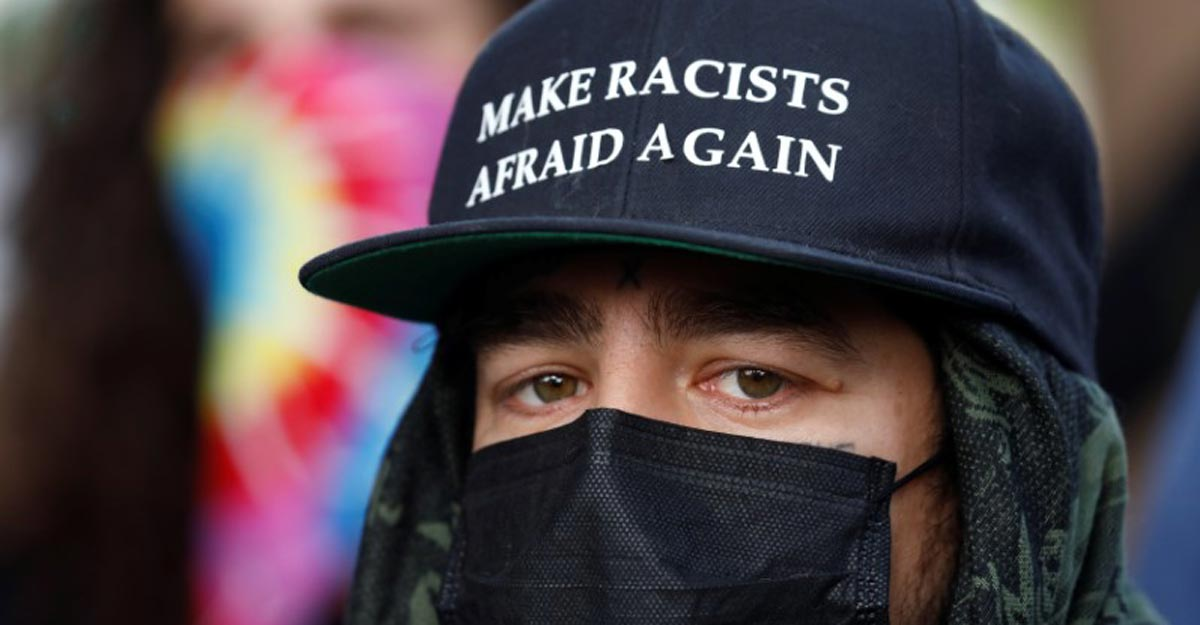 Column   Racial inequality fans the pandemic fire