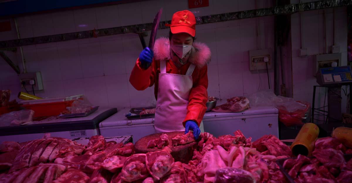Beijing district in 'wartime emergency' after virus cluster at major food market