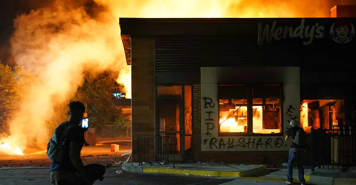 Protesters burn down Wendy's in Atlanta where black man was shot dead by police