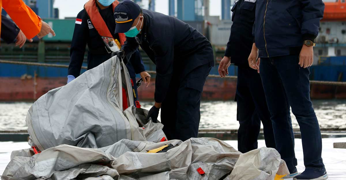 Indonesia locates black boxes of crashed jet, body parts recovered