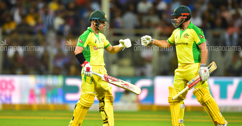 Australia's David Warner and Aaron Finch in action against India.