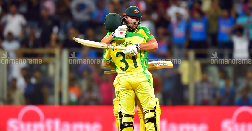 Australia's David Warner and Aaron Finch celebrate after beating India