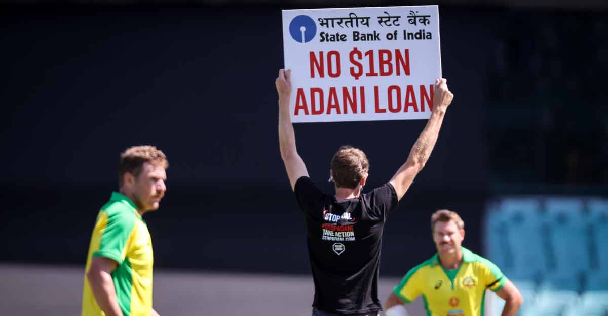 Two protesters invade SCG holding 'No $1B ADANI LOAN' sign during Australia-India ODI