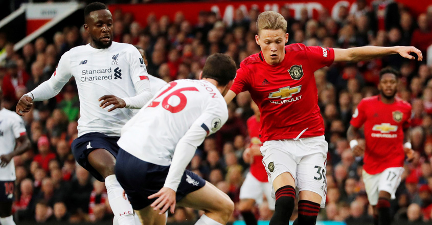 Premier League: Liverpool winning streak ends with draw at United
