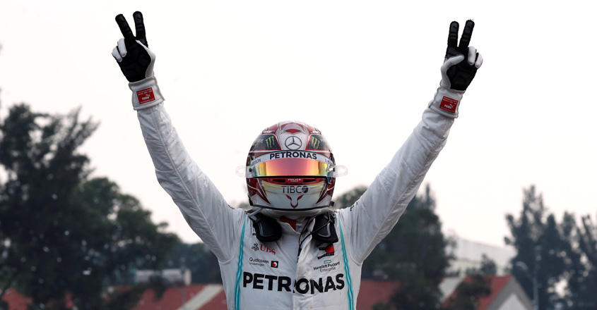 Motor racing-Hamilton wins Mexican GP but must wait for sixth title