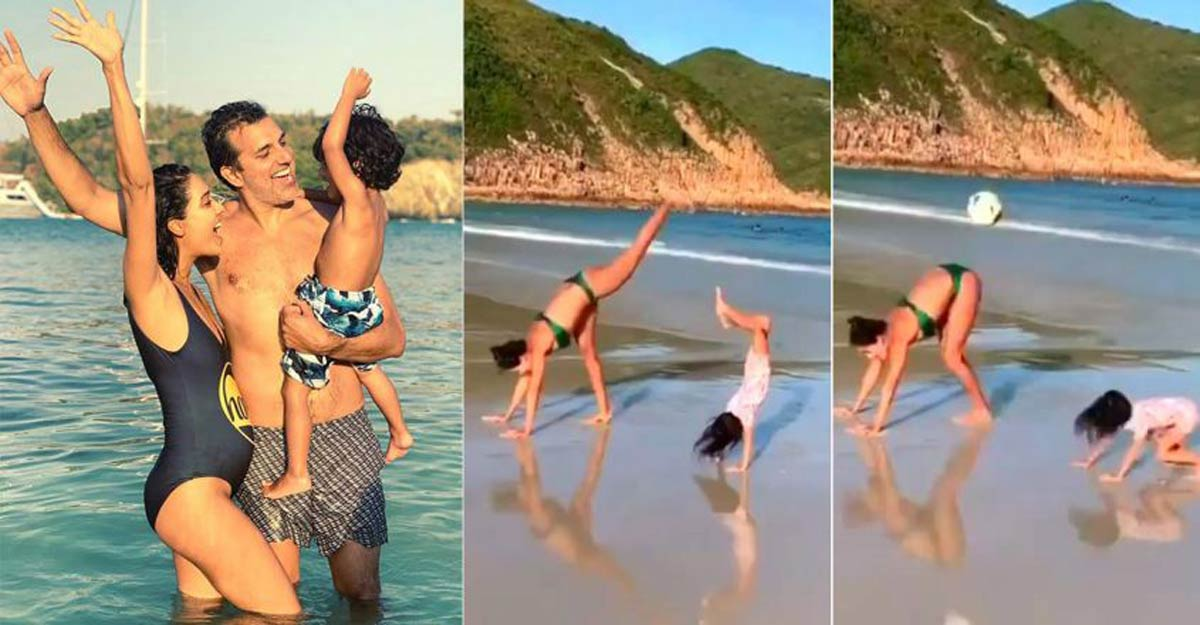 Lisa has a great time with son on Hong Kong beach
