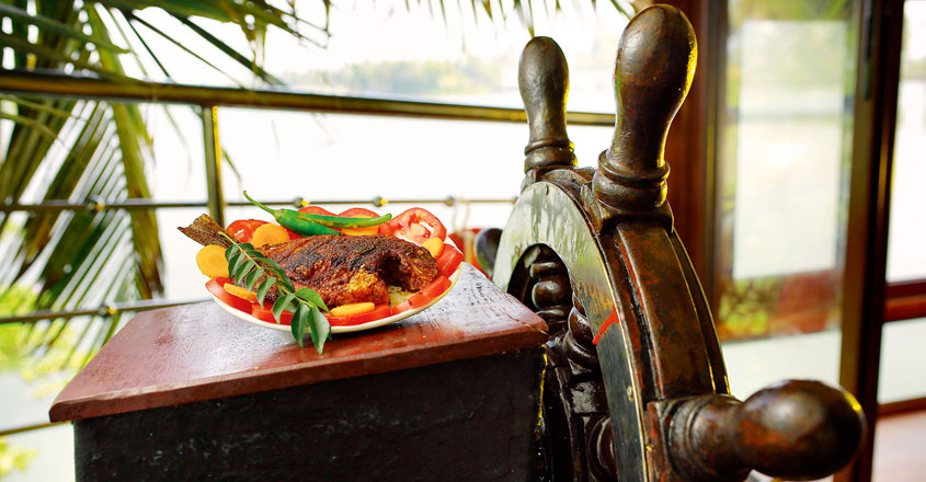 Cruise down Kuttanad, gently on a houseboat